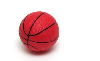 Small 8223 a toy basketball isolated on a white background pv