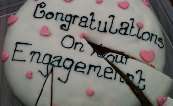 Small homemade engagment cake with small cute pink hearts